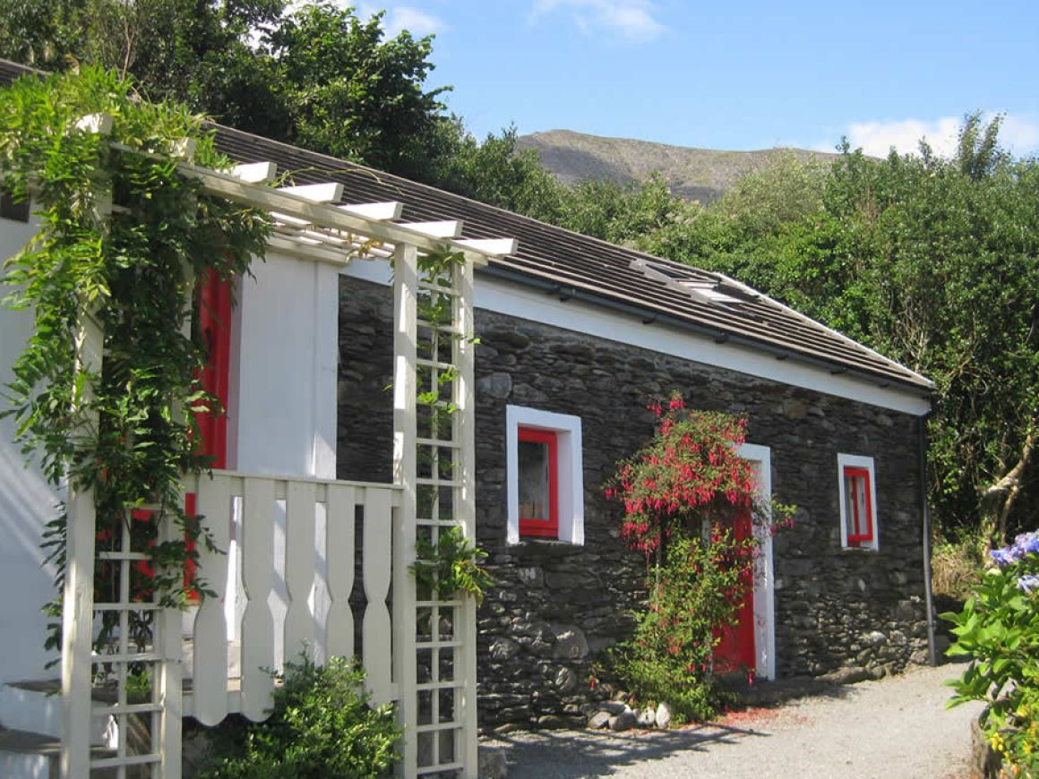 The cottage with Hungry Hill in the background